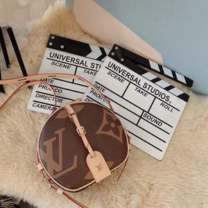 2019 Boite Chapeau Souple Womens Designer Luxury pequeños bolsos redondos Rivoli Brown cuero moda mujer Cannes manijas cadena vestido Totes