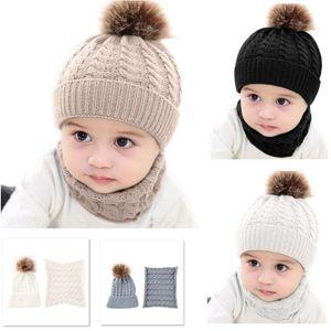 Caliente 2pcs / Set Invierno de punto de bola de piel Beanie Niños Scarf Cap otoño Sólido Collar Niño Niña niños del sombrero del sombrero de la bufanda de Navidad HH9-A2587