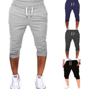 Мужская спортивная одежда для бега сухие фитнес-брюки сплошной эластичный пояс хлопок половина длины спортивные брюки быстросохнущие