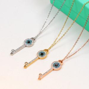 وارتفع الذهب اللون الأزرق كريستال نمساوي العين مفتاح قلادة قلادة الفولاذ المقاوم للصدأ النساء المجوهرات