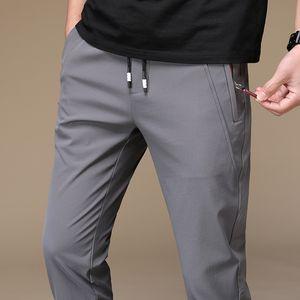 2020 Summer Men Sweatpants Warm thin Pants Loose Elastic Waist Pants Casual Trousers Big Plus Size 38