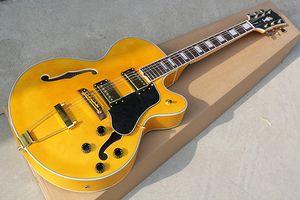 Factory Custom Double F Отверстия Палисандр Гермея Yellow Body Электрическая гитара с золотым оборудованием, черным пикавтором, может быть настроена