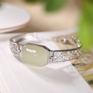 S925 prata incrustada de jade Hetian jade branco oca padrão de personalidade temperamento pulseira senhora para as mulheres de jóias