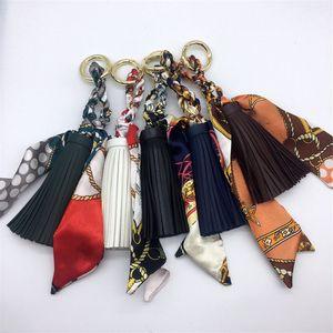 Женщины Luxury Keychains шарф Кожа PU Tassel ключевой цепи автомобиля держателя кольца Мода кулон сумка Шарм Keyring ювелирных изделий Аксессуары для девочек подарков