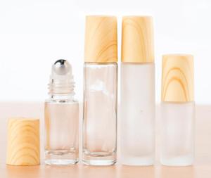 Esansiyel Yağ Parfüm 5ml 10ml SN için Buzlu temizleyin Cam Silindir şişeler Metal Silindir Ball ile Şişeleri Konteynerleri ve Ağaç Damarı Plastik Kapak