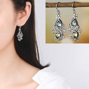 fiore creativo goccia a forma di pera popolare epoca mare europeo e americano blu topazio pendente in pietra orecchino femminile