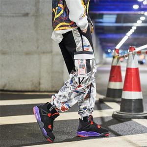 Pantaloni pantaloni della tuta elastica della vita Jogger Pantaloni Uomo Donne Street Fashion Cargo laterale Pocket Patchwork Uomo