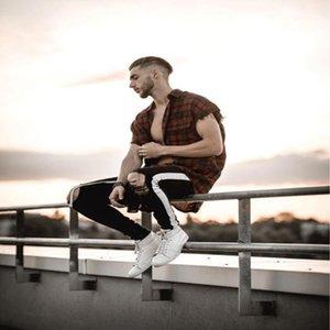 Ripped Zipper Crayon Biker Jeans Hiphop Rue Pantalones Hommes Représen Designer Jeans Noir Blanc Trous de genou rayé