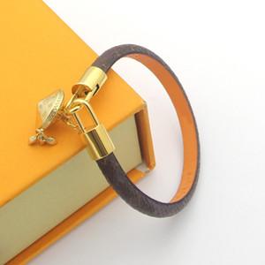 Joyería de lujo para mujer Diseñador de cuero Braceltes con el logotipo de la marca del corazón de oro en el gama alta de cuatro hojas Flores de cuatro hojas Pulsera de pareja