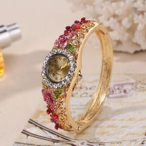 Modelos de explosión de las mujeres WATHCES Cloisonne 3D Retro Florecimiento Modelos mujer pulsera de reloj de cuarzo de la manera de la señora reloj de lujo