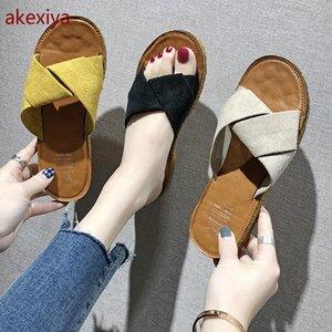 AKEXIYA сандалии и тапочки женщины 2020 летние женские сандалии с плоским дном крест тапочки мода повседневная