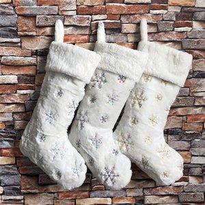 Los titulares del regalo del copo de nieve de Navidad Medias de imitación de piel de conejo de lentejuelas de Navidad del partido del calcetín de Navidad decoración de vacaciones de la familia