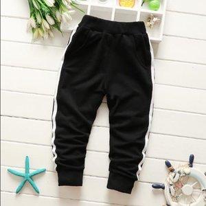 Nouveaux enfants portent des pantalons de coton bande de caoutchouc taille moyenne pantalon de survêtement de couleur unie taille 80-170cm