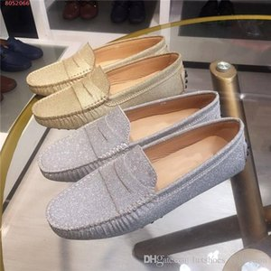 The spring summer women's leather loafers with T buckle cover are classic gold and silver driving-flat bean loafers