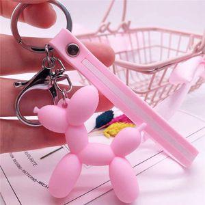 Globo de dibujos animados Key Chain perro colorido de goma suave del anillo dominante del PVC perro llaveros preciosos para las mujeres bolsas de regalos de joyas pendiente