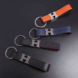Fashion Schlüsselanhänger Designer Unisex Schlüsselanhänger aus echtem Leder mit Edelstahl Schlüsselanhänger in Weißgold mit Schwarz