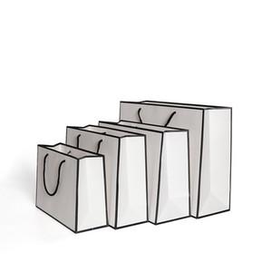 الهدايا بطاقة الأبيض تغليف أكياس حقيبة الملابس ورق كرافت الأزياء تخزين حقيبة التسوق الإعلان البيئة مخصص 1 86gr B2
