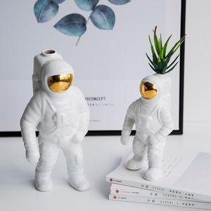 رجل الفضاء رائد فضاء إناء السيراميك نموذج فريد رائد فضاء الزهور المجففة السيراميك الأبيض لجدول أداة ديكور الأعلى