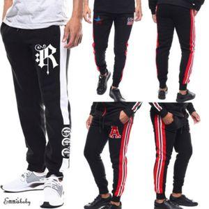 Homens Sports Calças executando uns bolsos de calças de desporto Athletic futebol calça de formação Elasticidade Legging de jogging Ginásio Calças