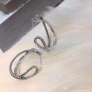 Thread rotating designer earrings simple men and women atmosphere new European and American popular ladies jewelry