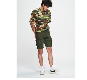 화물 바지 느슨한 지퍼 버튼 옴므 반바지 포켓을 가진 패션 편안한 캐주얼 의류 순수한 색깔 Mens