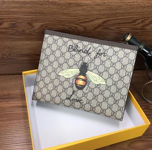 2020 embrague de cuero suave bolsa de abeja gran capacidad neta cartera de color rojo espíritu social del individuo hombres y las mujeres bolso de la manera nueva de cuero suave