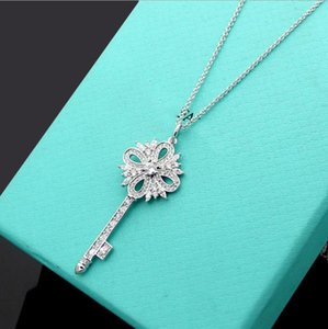 Snowflake key full diamond necklace women's gold version of Chinese knot key medium length sweater chain