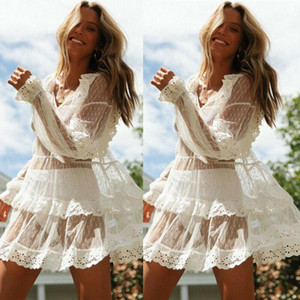 Nuevo verano Mujer Bikini Cover Up Floral Lace Hollow Crochet Swimsuit Cover-Ups Traje de baño Beachwear Tunic Beach Dress1
