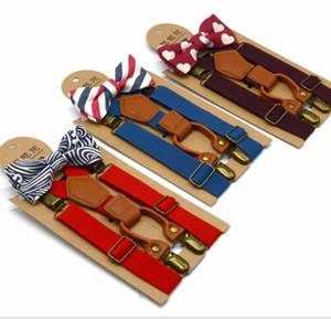 Los niños en forma de Y Suspender niños niñas 4 clip suspender elástico + raya impresa Arcos lazo 2 unids conjuntos niños ajustables cinturones lisos Y2597