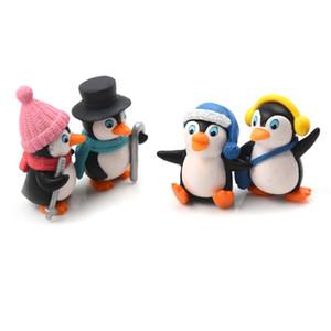 4pcs / set DIY XBJ196 Crafts Mini invierno del pingüino miniatura Figuras de Navidad Figuras para Fairy gnomos del jardín musgo terrarios Decoración