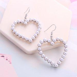 Japan and South Korea hollow soft adorable heart sweet simple Pearl Earrings geometric girl heart Joker earrings
