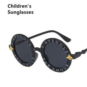 Çocuklar Için yeni Lüks Tasarımcı Güneş Gözlüğü Moda Yuvarlak Yaz Tarzı Kız Erkek Güneş Gözlüğü Çocuklar Plaj Malzemeleri UV Koruyucu Gözlük T141