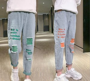 Best selling girls' spring and autumn loose hole jeans 2020 new Korean children's trousers factory direct sales of 110-140cm