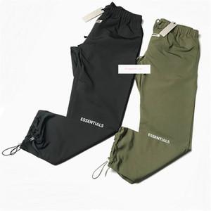 Reflectante fina de nylon Pantalones deportivos ligero del verano flojo del basculador elástico Puños de tres bolsillo estilo