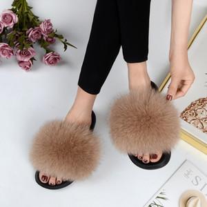 Verano 2019 Diapositivas de piel para mujer Zapatillas de piel de zorro real Deslizadores interiores Moda Piel genuina Alta calidad