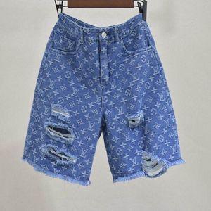 Tie-in flower jean shorts female 2020 European version high waist broken hole classic joker show thin blue casual fashion summer pants