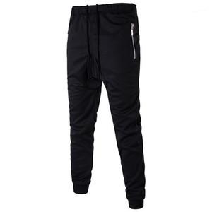 Cordão Pants Fashion Designer Mens Harem Pants Hip Outono Pop lápis calças com bolsos Mens Casual solta