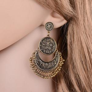 Fleurs exotiques Sculpté Vintage Boucles d'oreilles en métal exagéraient Tassel Boucles d'oreilles pour les femmes Achats en ligne Inde E571