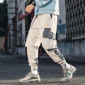 Iidossan 2020 Multi bolsillos Cargo pantalones hombres Patchwork pantalones Casual Joggers mujeres Harajuku Streetwear pantalones Hip Hop monos