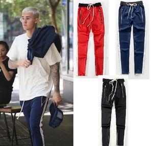 Moda-Hombres Mujeres Pantalones con cremallera lateral Hip Hop Fear Of God Pantalones de algodón Pantalones de chándal casuales de marca popular Pantalones negros rojos