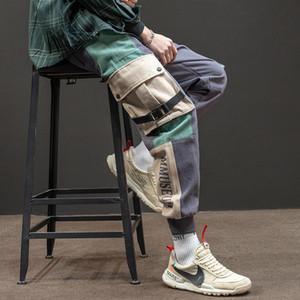 Calças nova Carta Fitas de carga Homens Streetwear Primavera Outono Casual Hip Hop grandes bolsos Imprimir Sweatpants Calças Harem Pants