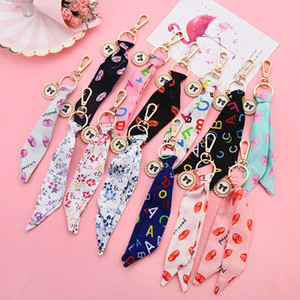 Coréenne ruban de soie Keychain bowknot perle Sac disque Pendentif Fashion Lady Pendentif Petit cadeau