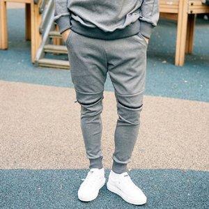Primavera de fitness nuevo músculo deportes para hombre de las bragas deporte casuales de la moda agujero sweatpant auto-cultivo de la cremallera de los pantalones pies pantalones de guardia