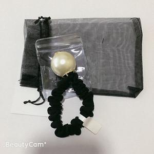 Moda C clásico de cuerda de pelo hacia atrás con sellos, hecho a mano cabeza grande la bola de pelo cuerda de pelo de la perla anillo de la cabeza banda de goma regalo tocado vip