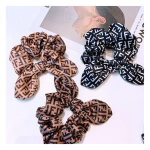 Modelo retro de la letra impresa de las mujeres anillos de pelo clásico nudo del arco de Bandas Señora de goma de pelo de alta elasticidad chica cola de potro vendas