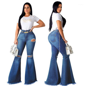Bootcut Jeans manera lavó el rasgado de la llamarada Mujer pantalones casuales flacos de las señoras sólidas Pantalones para mujer primavera Hole
