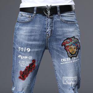 Unique Mens Badge Blue Slim Fit Jeans Fashion Designer Skinny Washed Motocycle Denim Pants Panelled Hip Hop Biker Trousers