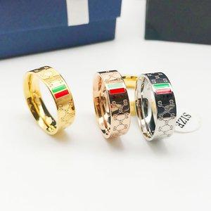 De lujo anillo de titanio de acero 316L con el logotipo Hombres Y Mujeres alta calidad diseñador de la joyería anillo de la marca famoso RedGreen G 1pcs envío de la gota
