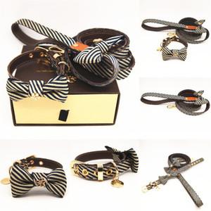 Nuevo collar de perro de diseño clásico patrón de diseño + traje de correa de la PU collar del animal doméstico de cuero ajustable de marca correa de la personalidad del gato al aire libre cute pet