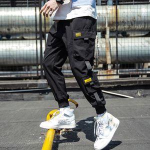 Marca Designer Primavera Hip Hop Corredores Homens Pretos Harem Pants Multi-bolso Fitas Man Sweatpants Streetwear Casual Calças Mens Carga